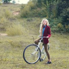 beautiful blonde and vintage bike