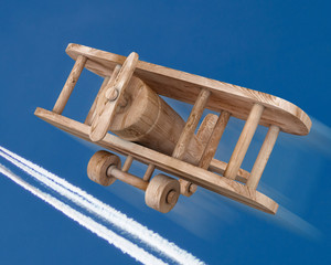Wooden plane on a sky