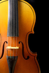 Close up of a violin isolated on black