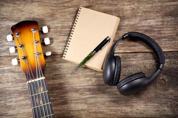 headphone guitar notebook pencil