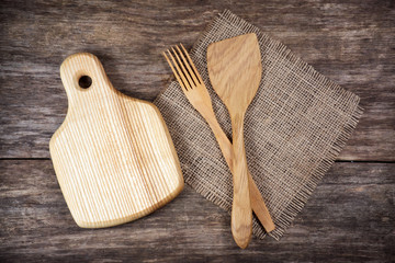 Empty chopping board and kitchen utensils