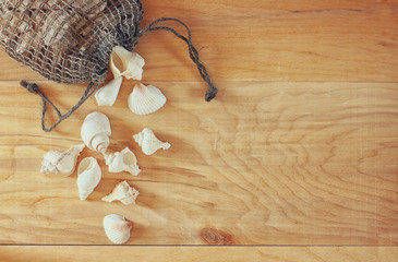 Top view of natural seashells on wooden table