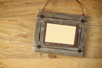 Top view of old nautical wooden frame on wooden table