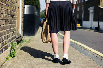 Woman in skirt walking the street