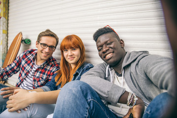 Multiracial group taking selfie