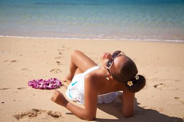 Young fashion woman relax on the beach, sun worshiper.