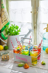 Cold drink with straw and fruits