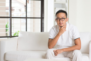 asian casual male sitting on sofa