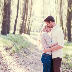 romantic couple in the woods