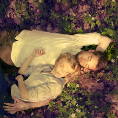 couple in love lying in the spring forest