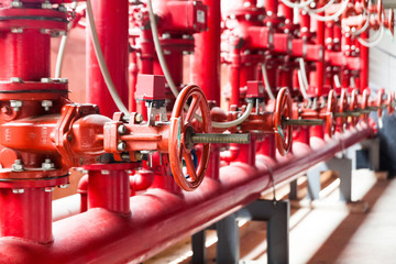 A row of red color fire fighting water supply pipeline system