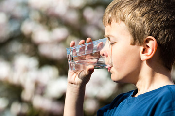Boy drinking pure water from glass