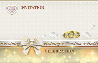 wedding card with rings and hearts