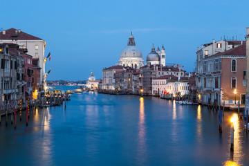Grand Canal and Santa Maria della Salute at night in Venice.