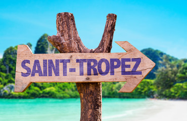 Saint-Tropez wooden sign with beach background