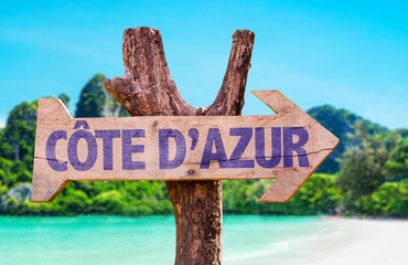 Cote D'Azur wooden sign with beach background