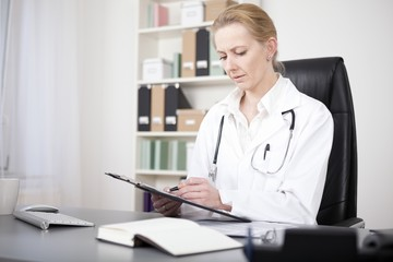 Serious Woman Doctor Reviewing Written Findings