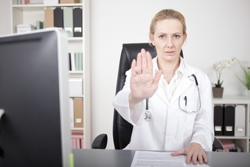 Serious Female Doctor Showing Stop Hand Pose