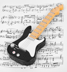 Wall Mural - Toy guitar and music sheet