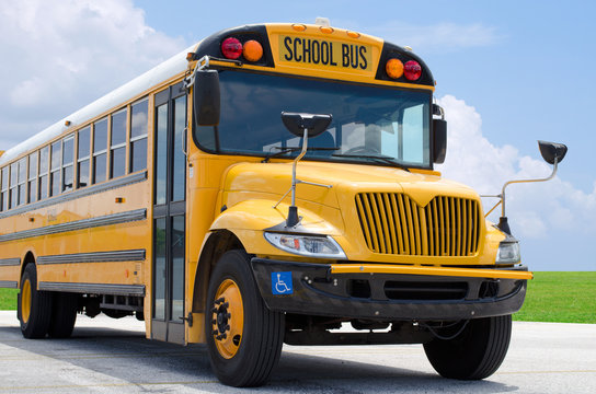 School bus on blacktop with clean sunny background