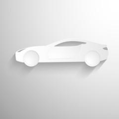 Cut paper forms a sport car silhouette.