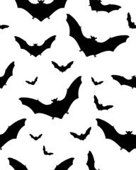 Seamless pattern with black silhouettes of bats on white
