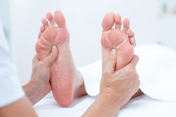 Physiotherapist doing foot massage