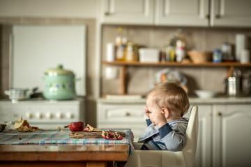 Happy baby eating fruit