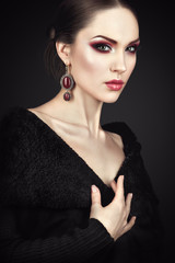 Beauty portrait with fashion makeup on black background