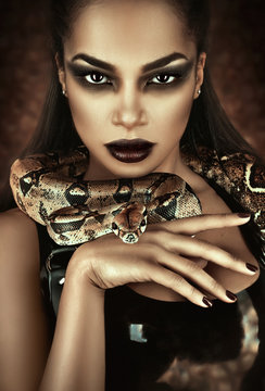 Close up portrait of sexy woman with snake