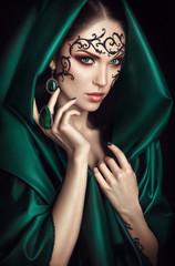 Beauty portrait with lace face-art