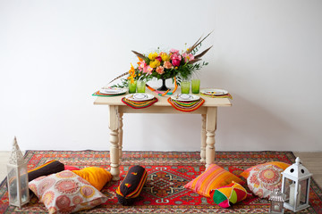 bright boho flowers on the served table