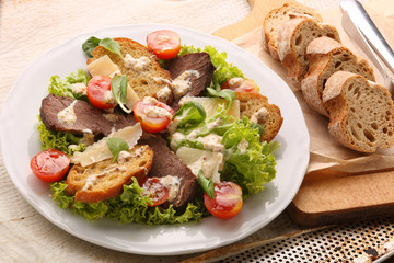 Toast with roast beef cheese and fresh spring vegetables