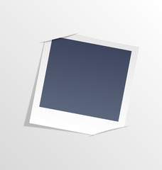 Photo frame inserted in slits of white sheet of paper