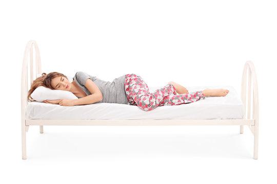 Beautiful brunette woman sleeping in a bed