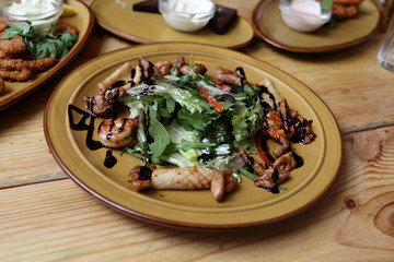 Plate of salad with quid on the table