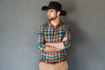 Serious and confident cowboy. Wall mural