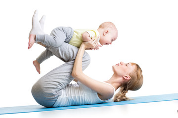 cute mother having fun with her son doing yoga exercises