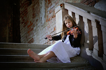 Small violinist in an abandoned house