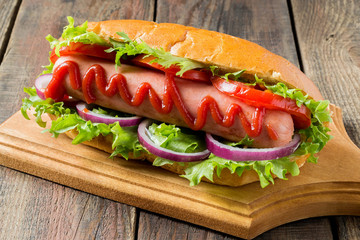 Hot dog with tomato and lettuce