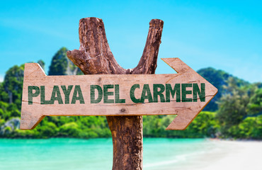 Playa Del Carmen wooden sign with beach background