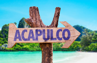 Acapulco wooden sign with beach background