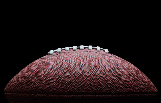 American football over black background