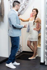 Young couple at fitting room.
