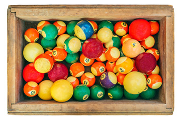 Ancient pool billiard balls in a wooden box