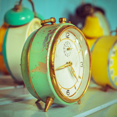 Retro syled image of ancient alarm clocks