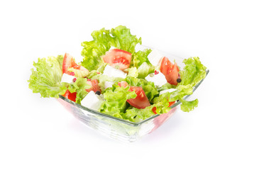 Green salad with tomato and cheese in a bowl