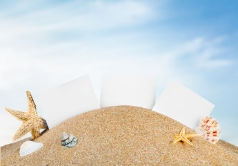 Travel. Photo frames on the sea sand on the beach background