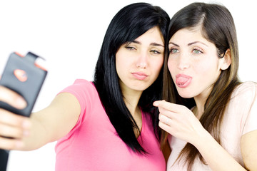 Girls making funny faces taking selfie