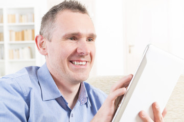 Deaf man using tablet